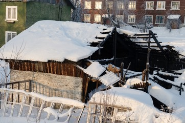burnt building under the snow