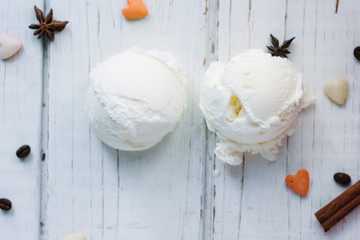 Two balls of ice cream on white board.