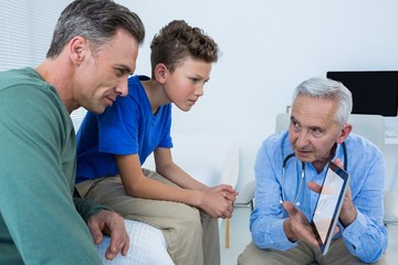 Doctor and patient discussing over digital tablet