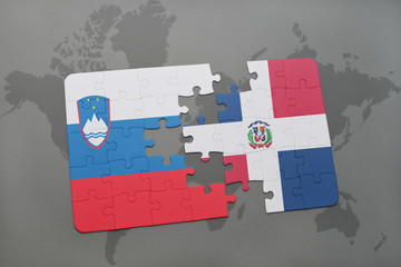puzzle with the national flag of slovenia and dominican republic on a world map