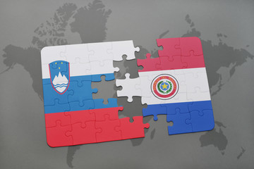puzzle with the national flag of slovenia and paraguay on a world map