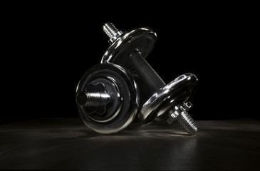 dumbbell on the wooden floor