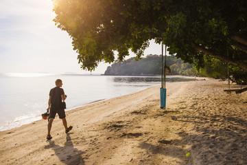 Man walking on the beach in Thailand