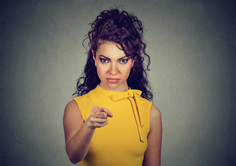 Portrait of a woman pointing finger at you