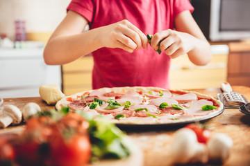 Girl preparing pizza