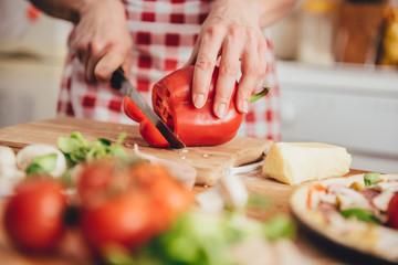 Woman slicing paprika