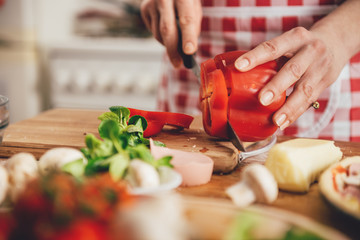 Woman slicing paprika
