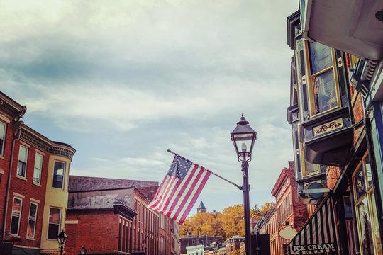 Shops along main street, Galena, Illinois, focus on flag, toned