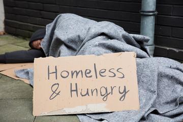 Homeless And Hungry Man Sleeping