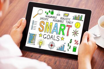 Businessperson Using Digital Tablet Showing Smart Goals Concept