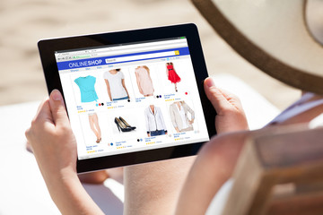 Woman Doing Online Shopping On Digital Tablet