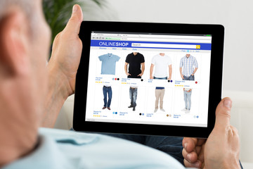 Close-up Of Person Shopping Online On Digital Tablet