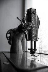 The old sewing machine at a window