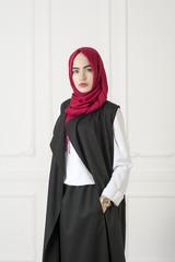 Islamic beautiful woman in a modern oriental dress, studio photo