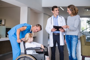 Doctor discussing medical report with mother