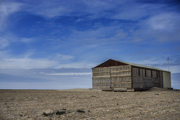 Desert landscape, lonely house at the sand.