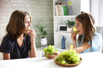 Teenagers eat fresh organic grapes