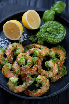 Tiger shrimps served with parsley sauce and lemon, closeup