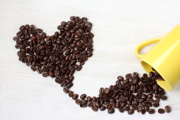 flavor of true love/ roasted grains black coffee, poured at desk of the yellow circles, forming a heart shape