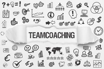 Teamcoaching / weißes Papier mit Symbole
