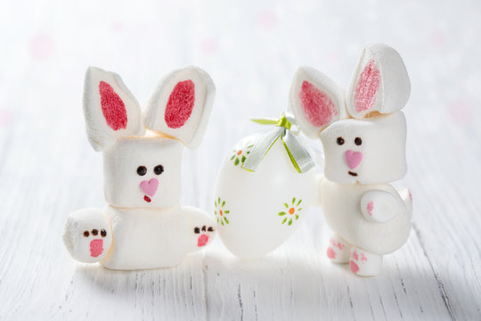 Funny marshmallow rabbits with Easter egg, sweet bunnies