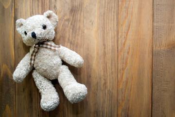 Teddy bear on wooden background