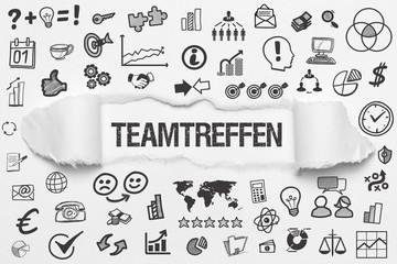 Teamtreffen / weißes Papier mit Symbole