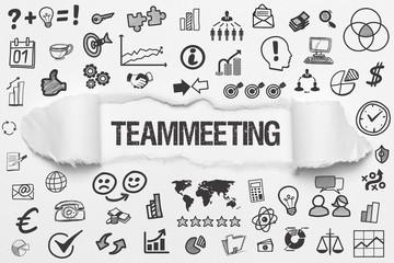 Teammeeting / weißes Papier mit Symbole