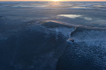 Nature landscape north break the ice of the Gulf in the light of sunset