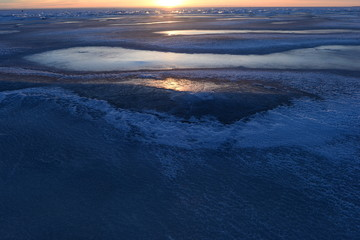 The natural beauty of the winter landscape ice cold in the light of sunset