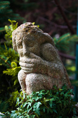 statue in the garden with a closed mouth