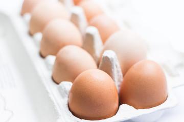 Eggs Inside Paper Box on Light Background