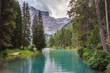 Wall Mural - View of the Braies Lake (Lago di Braies, Pragser Wildsee) at dusk. Braies lake is one of the most famous Italian alpine lake, situated in South Tyrol, Italy.