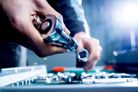Tools at the hands. Auto repair