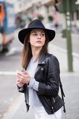 Young stylish woman in the street