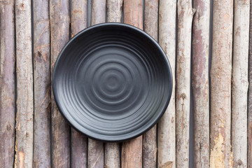 Black plate on a wooden floor.