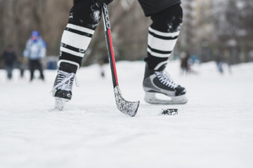 hockey player runs with the puck on the ice