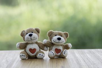 Couple Teddy Bears on the wooden floor.