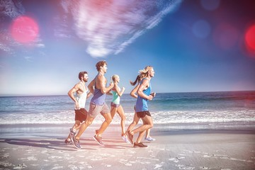 People jogging on beach