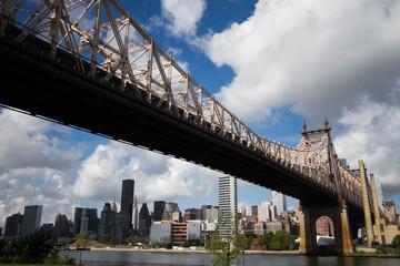 Queensboro bridge and Manhattan with cloudy sky