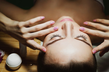 Beautiful natural girl woman in the spa salon, It makes a face massage, facial rejuvenation procedure, spa treatments. Visit a beautician, massage lines. Cosmetology. Massage Toffa. Mesotherapy