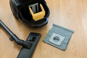 inside Vacuum cleaner and dust bag on the floor