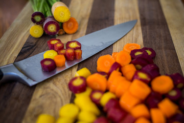 Assorted carrots chopped with knife