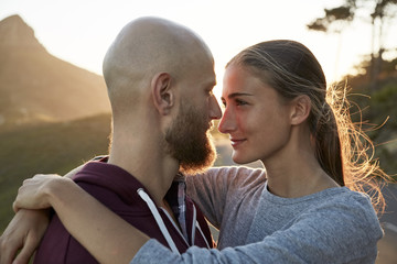 Young couple in love face to face at backlight