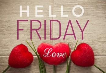 Hello Friday words on red heart and wooden background