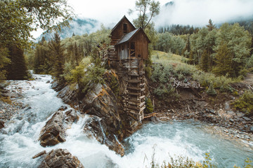 Wooden hut by river