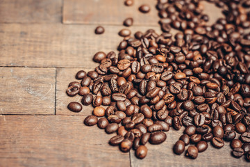 coffee beans scattered on a wooden background