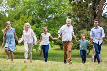 Multi-generation family enjoying together in park