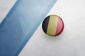 old hockey puck with the national flag of belgium