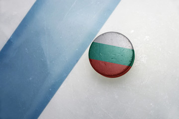 old hockey puck with the national flag of bulgaria